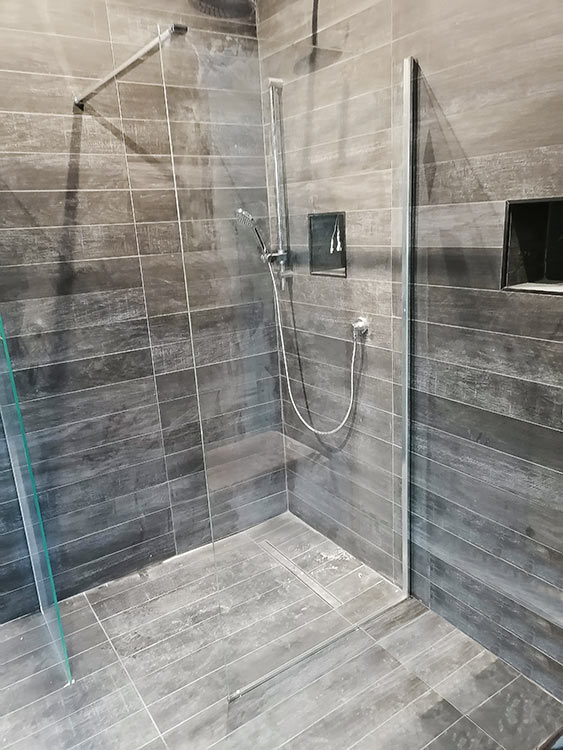 Wood effect porcelain floor tiles in shower
