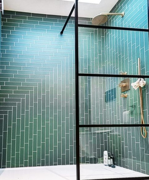 Shower ensuite herringbone green wall tiling