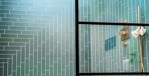 Shower ensuite herringbone green wall tiling
