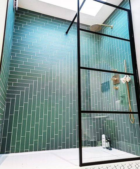 Shower ensuite herringbone wall tiling